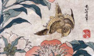 A piece of Japanese art showing a bird flying through flowers.