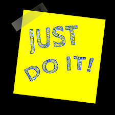 "A Post-It™ note that has ""Just Do It!"" handwritten on it."