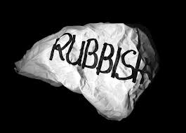 "A crumpled piece of paper with the word ""rubbish"" written on it."