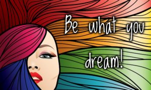 """A woman with rainbow colored hail, and the words, """"Be what you dream!"""""""