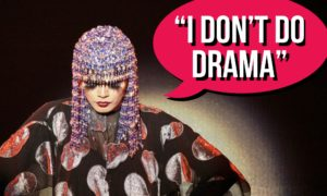"""A heavily theatrical woman with a speech bubble saying. """"I Don't Do Drama."""""""
