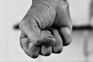 A close-up image of a fist in black and white.