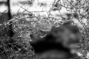 A dark image of broken glass representing the self and consent.