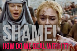 A screen from Game of Thrones showing Cersei on her walk of shame.