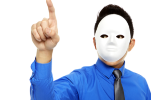 A man in a dress shirt and tie wears a white featureless mask.